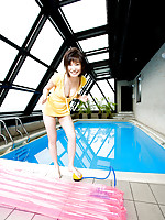 Nao Nagasawa Asian shows big boobs and nice smile at the pool